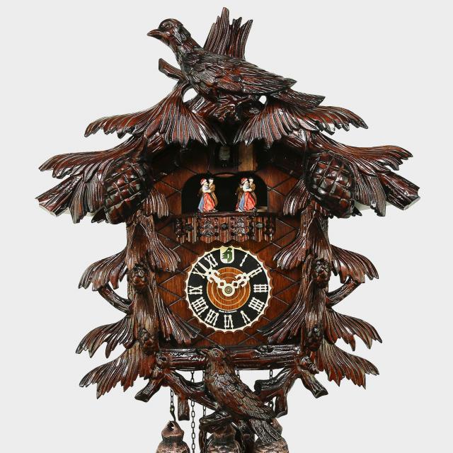 Reloj cuco- motivo de pájaro